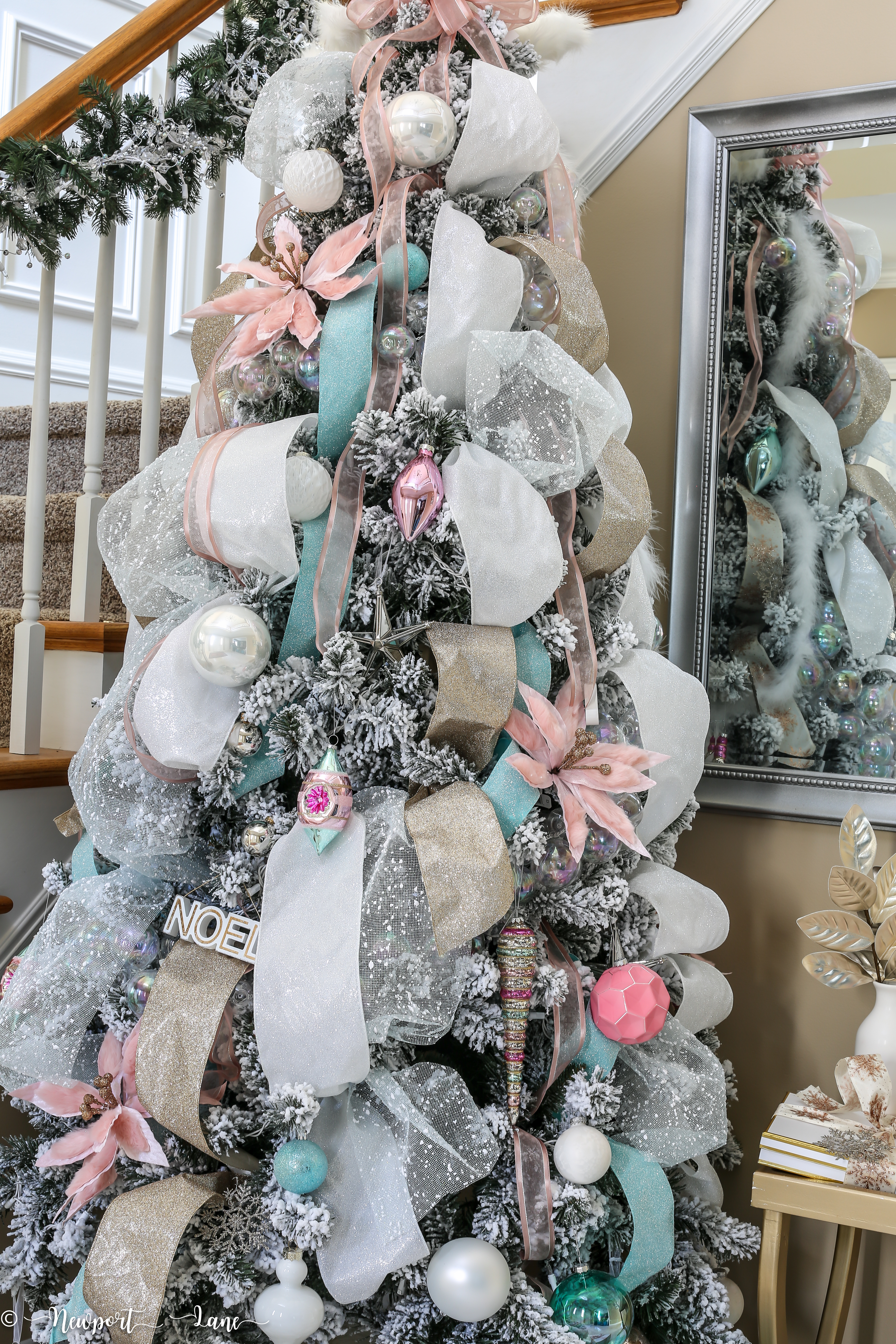 Blush, white and blue Christmas tree. Blue ornaments. Gold ornaments. White ribbon. #christmastree #christmasdecorations