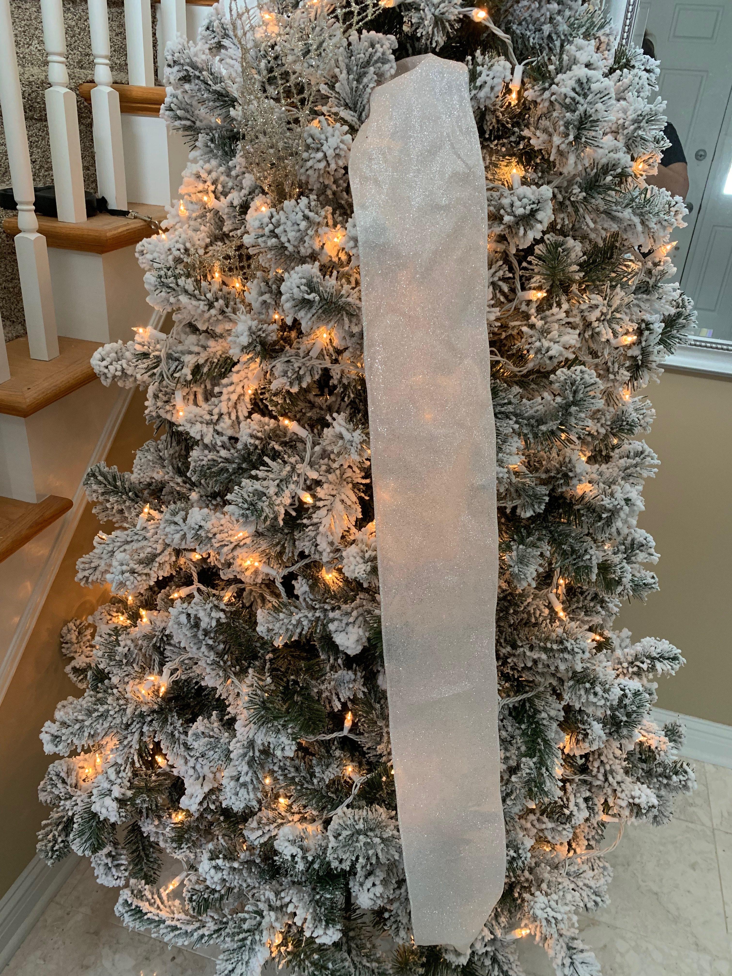 How to Add Ribbon to a Christmas Tree. #christmastree #ribbongarland #christmas