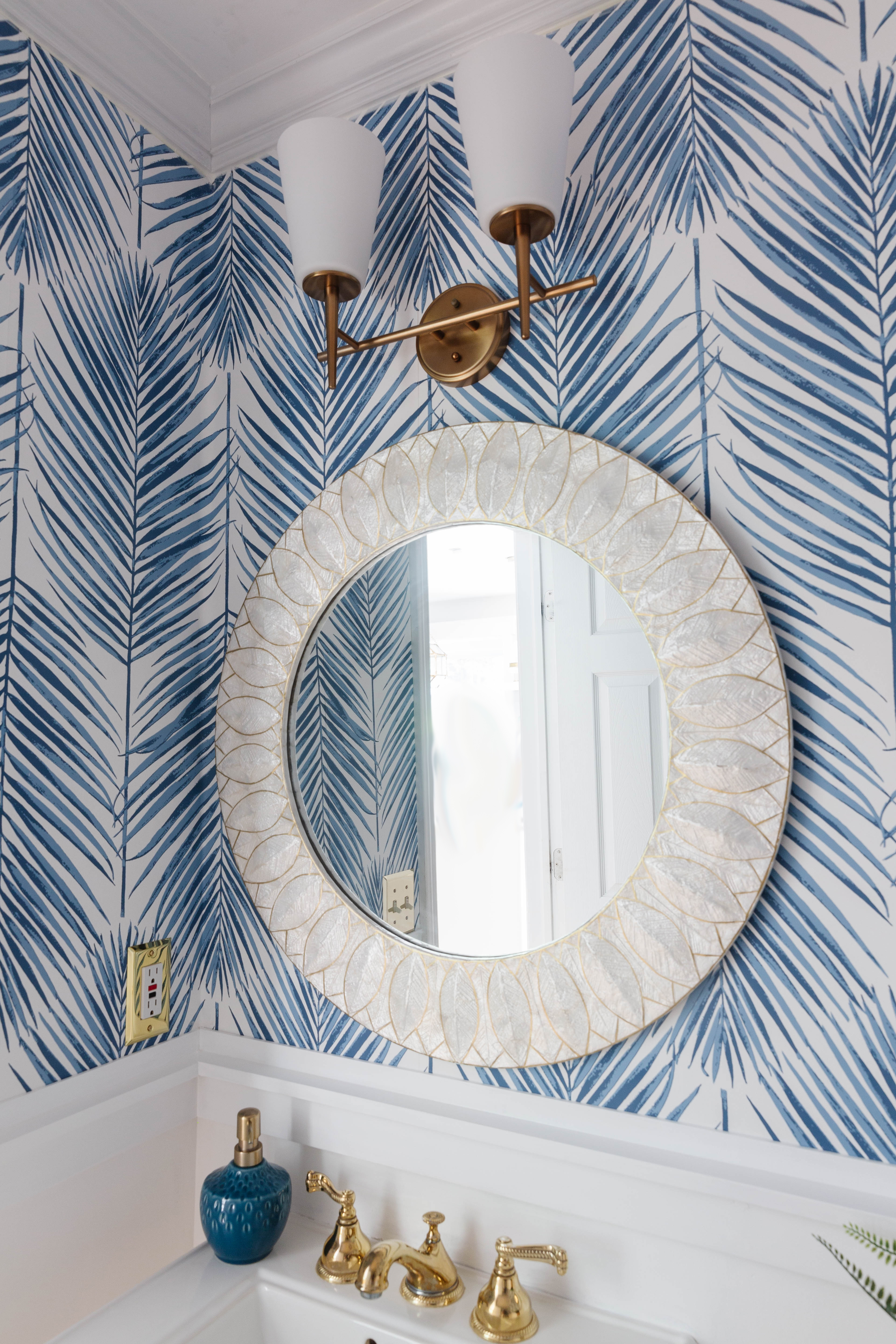 Here is our blue and white coastal powder room! I am so, so happy with how it turned out. The first few days, I kept walking by and staring at it. LOL! I guess that's what happens when you put in the hard work and effort of doing all of the work yourself!
